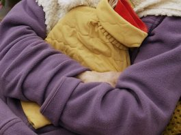 Photograph of Woman With Hot Water Bottle