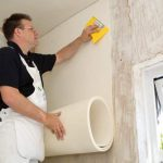 Photograph of insulation installer