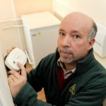 Photograph of Malcolm Farrow, OFTEC with Carbon Monoxide Alarm - Say No To CO