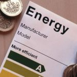 Photograph of currency and energy efficiency data