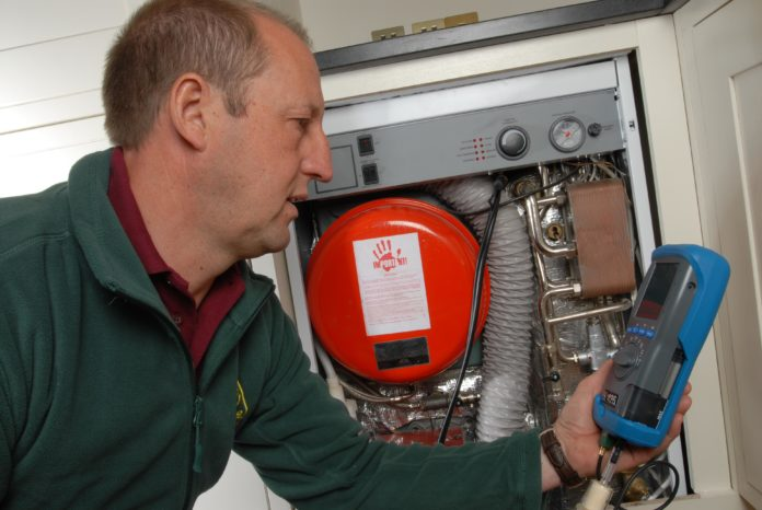 OFTEC Technican checking for Carbon Monoxide Spillages